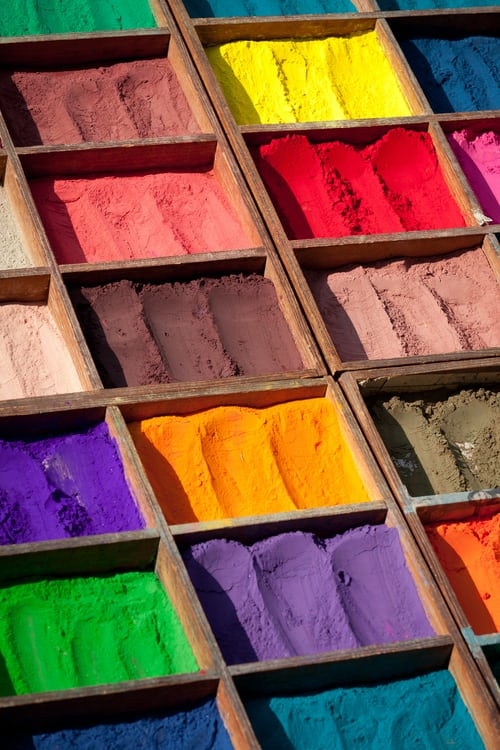 Boxes full of colored powders, you can use color therapy to take advantage of colors