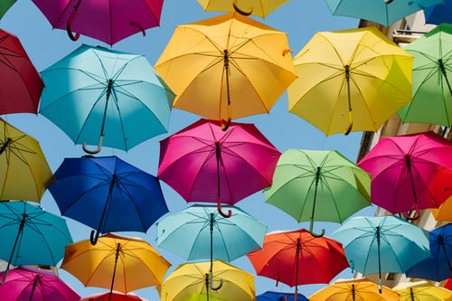 colored umbrellas hanging in the sky