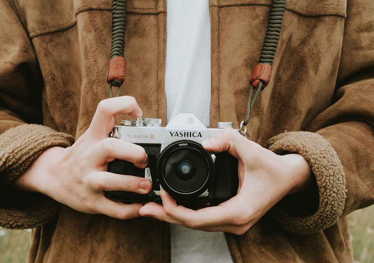 a boy with a camera in his hand