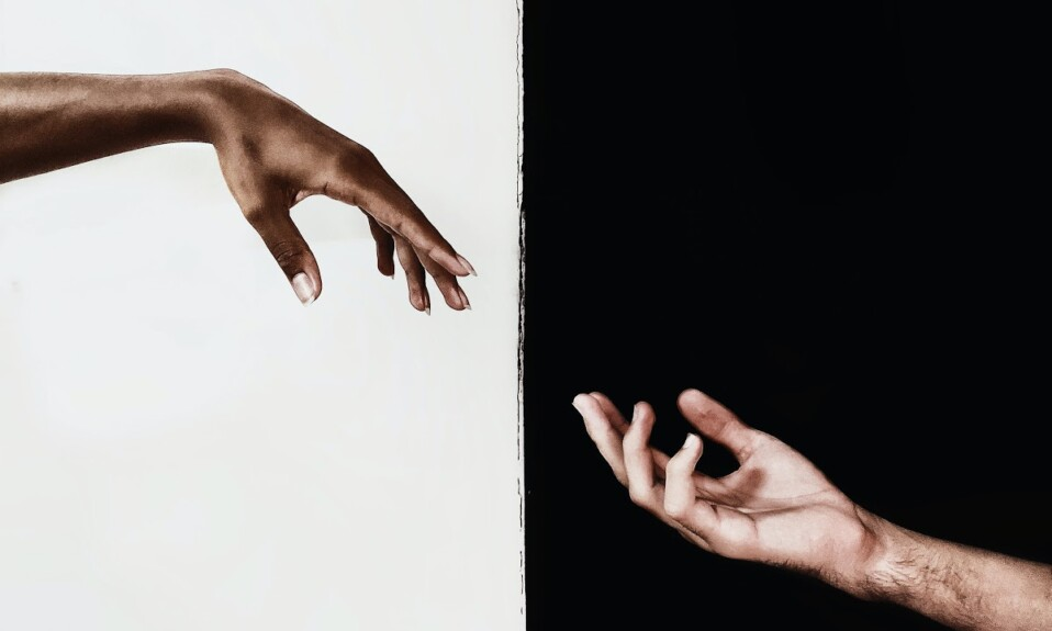 two hands and the color contrast between them