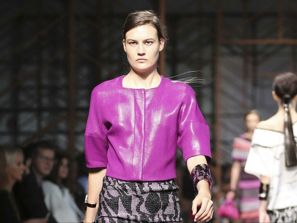 a girl with a coat in radiant orchid