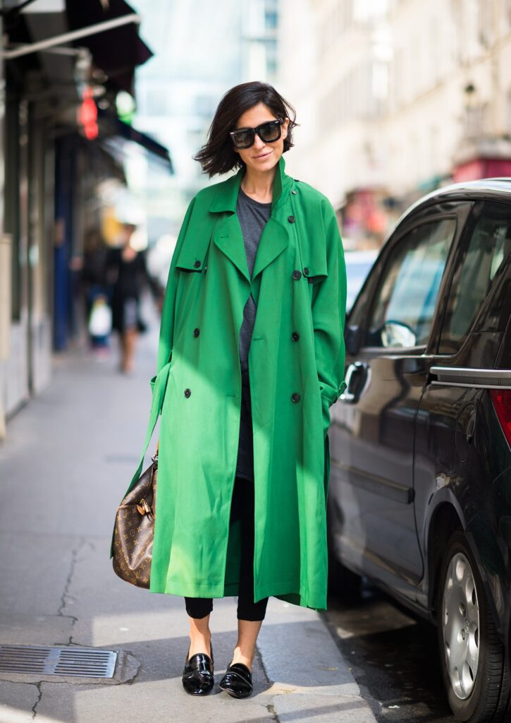 a girl with raincoat in emerald
