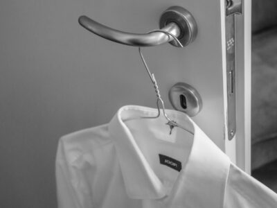 white shirt hung on the door