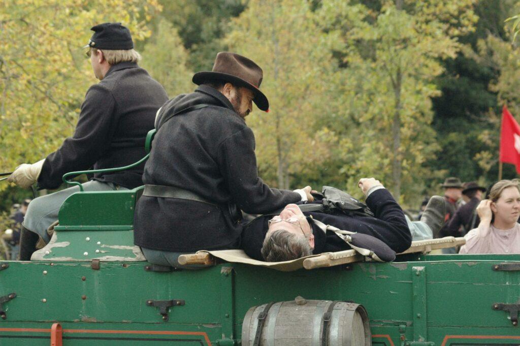 men in the green car
