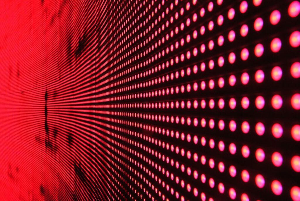 red neon wall in monochrome color photography