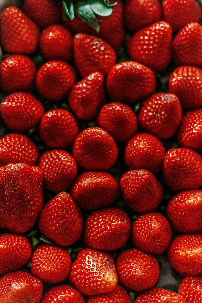 monochrome color photography of red strawberries