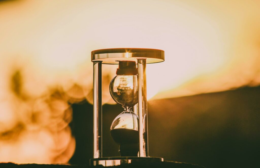sepia hourglass in the sunset  in monochrome color photography
