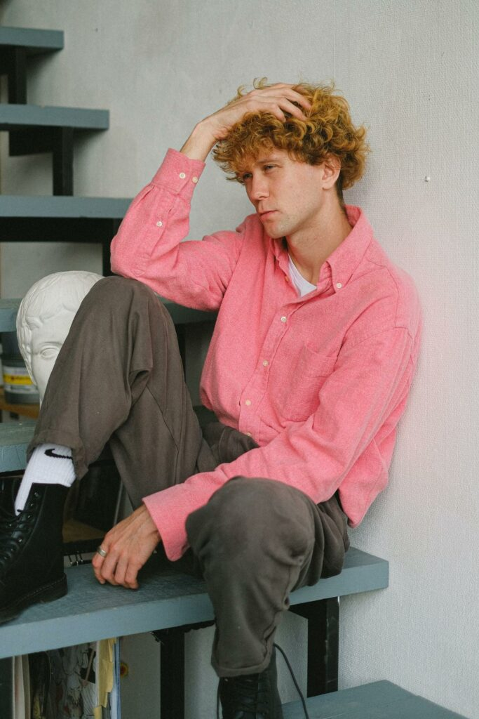 a boy in a pink outfit