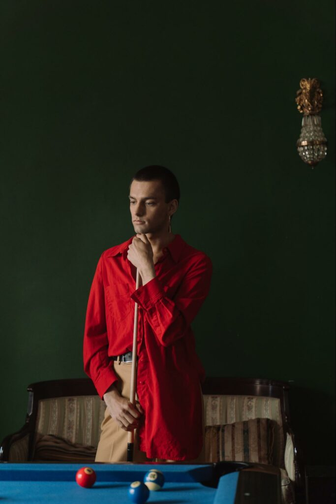 a boy in a red outfit