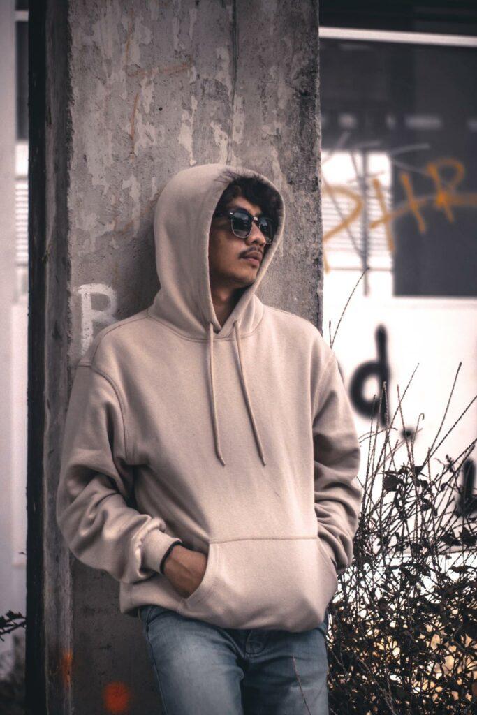 a boy in a cream hoodie