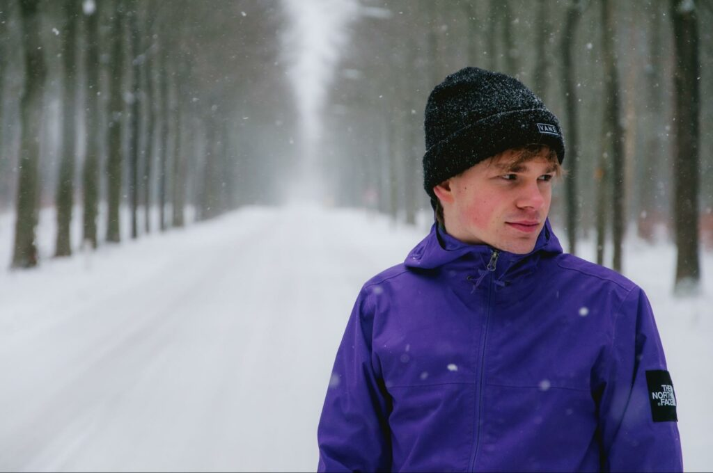 a boy in a purple outfit