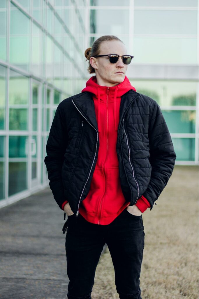 a boy in a red hoodie