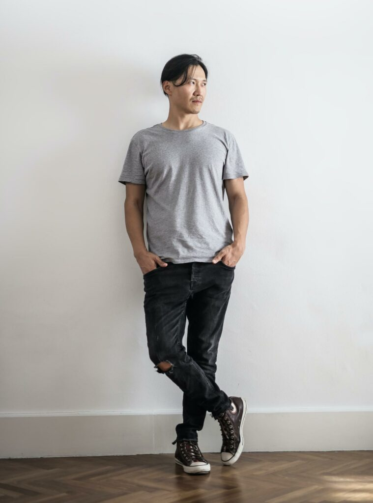 a boy in a gray outfit