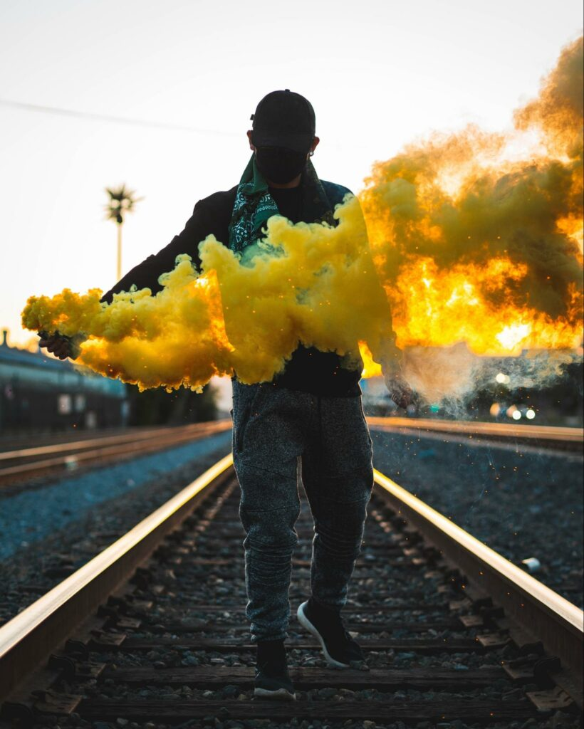 a man with yellow smoke
