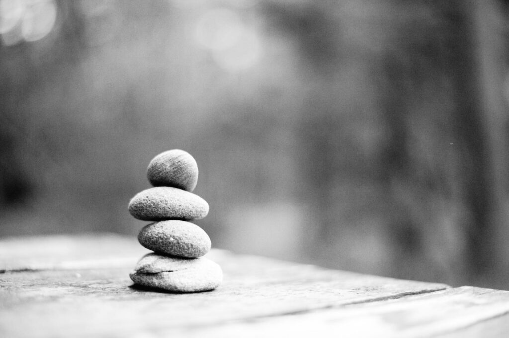 monochrome of four stones stacked on top of each other
