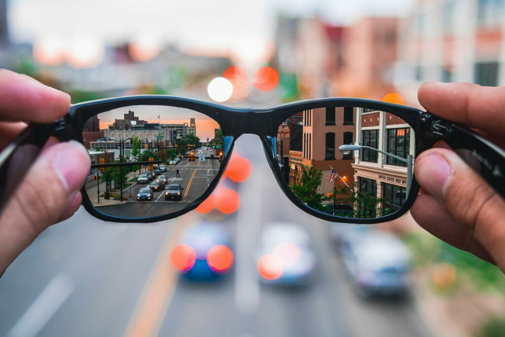 combined image of a street in a pair of glasses