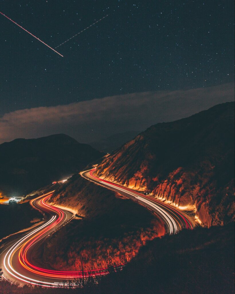 long exposure photography of cars on a road