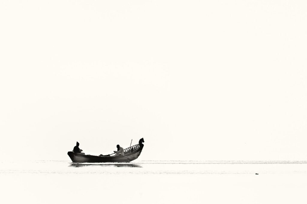 photograph of a boat and two man