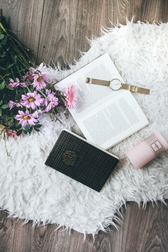 image of books, watch and bouquet