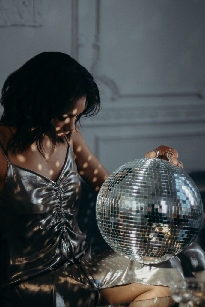 a girl with silver color dress and ball