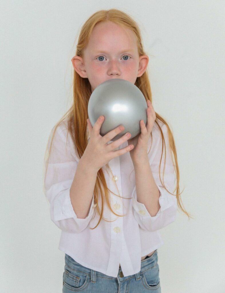 a girl with silver ballon