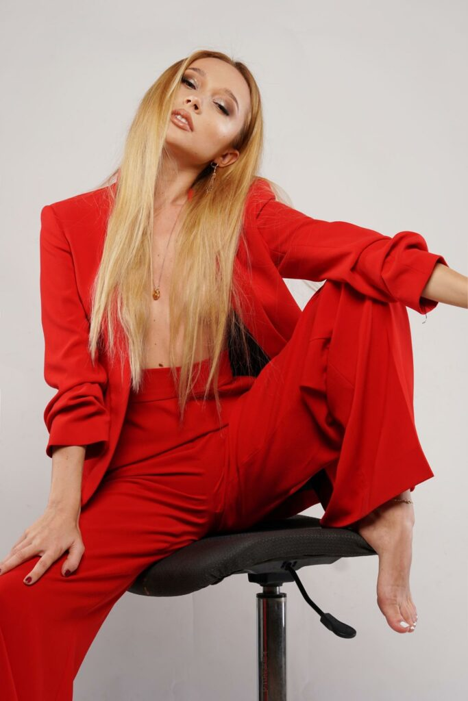 a girl with  red long overcoat