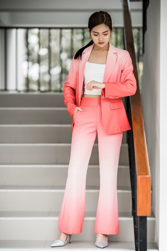 a girl with  pink long overcoat