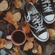 a pair of all star on autumn leaves