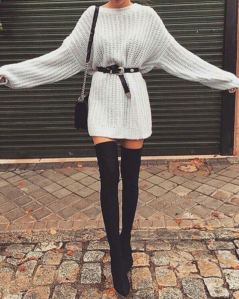 a girl with long knitwear and black belt