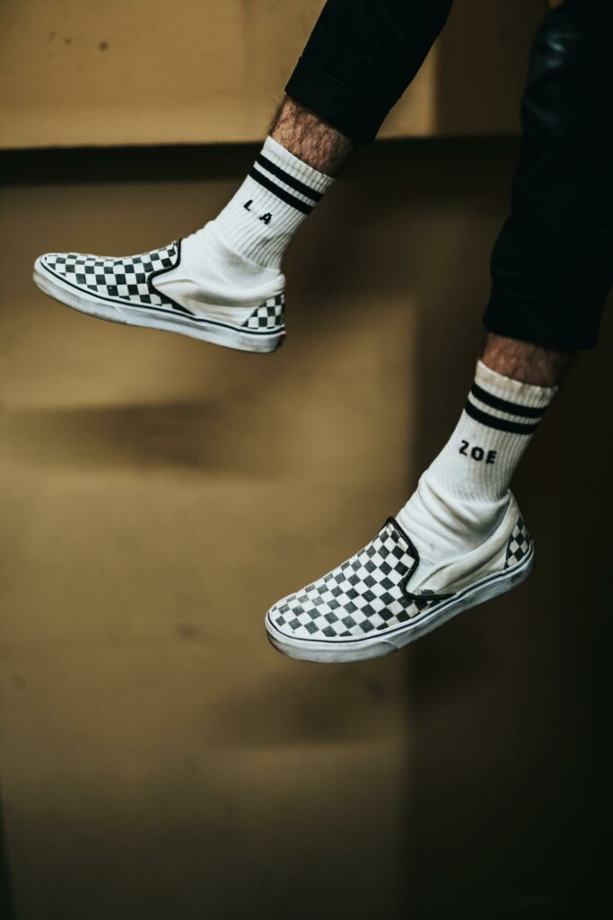 a boy that wear black and white socks