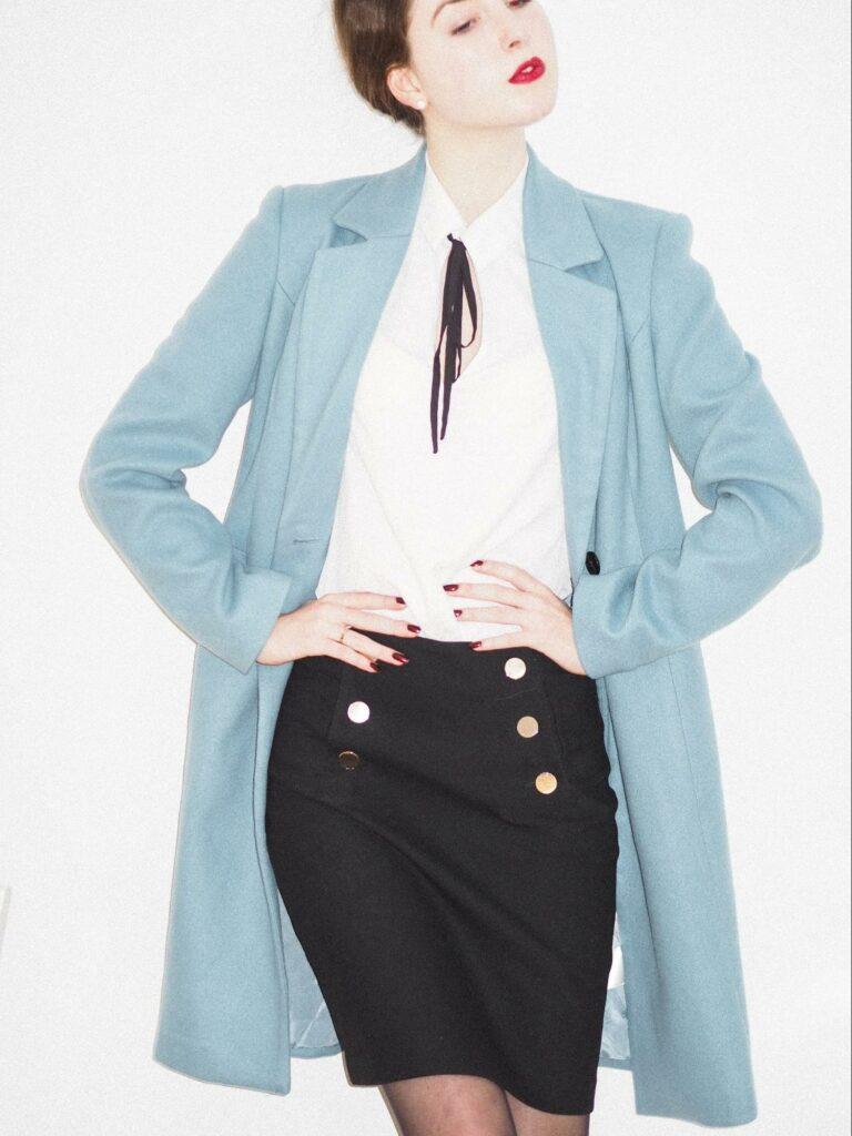 a girl that wear blue coat