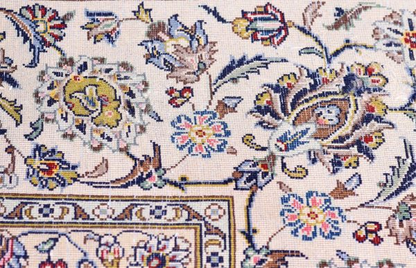 A Persian carpet with beige and white symbolizes positive imagery