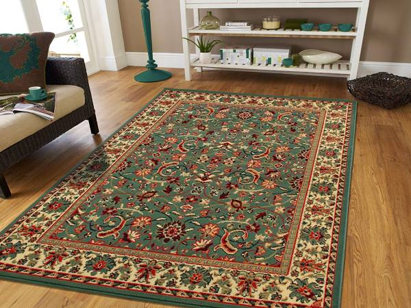 A green Persian carpet with colorful patterns on the floor represents health and growth