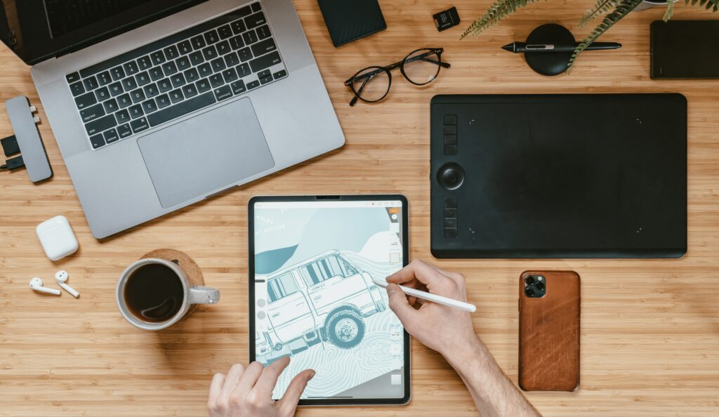 a man draw a car by his tablet