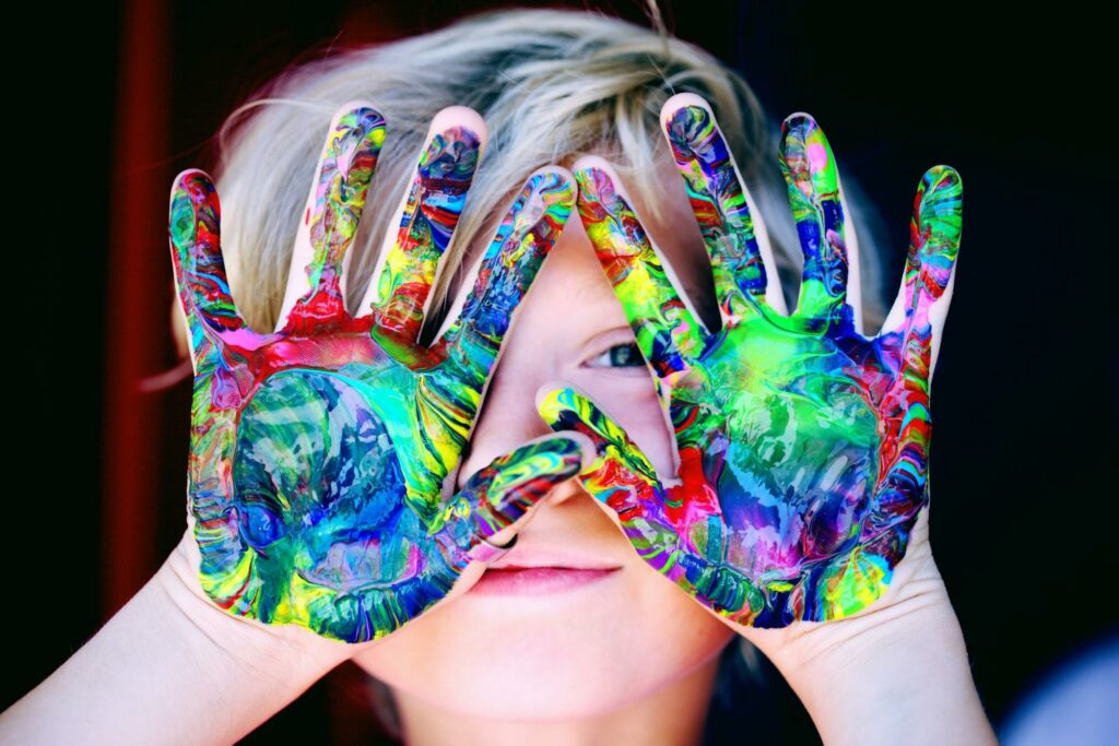 a child with colored hands
