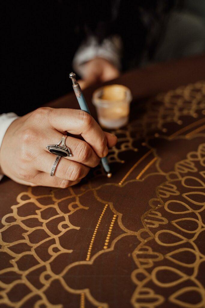 woman drawing mandala
