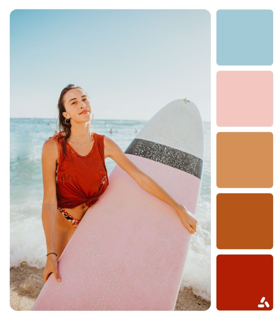 a girl with her surfboard in the summer
