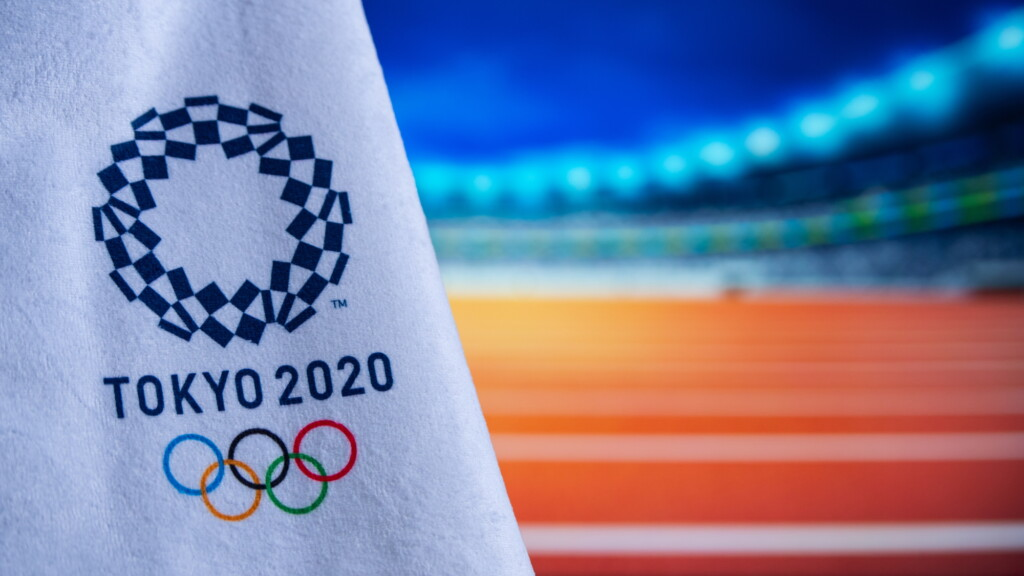 the flag of summer Olympic Tokyo 2020 with a white background and five rings of the Olympic symbol and written by Tokyo 2020