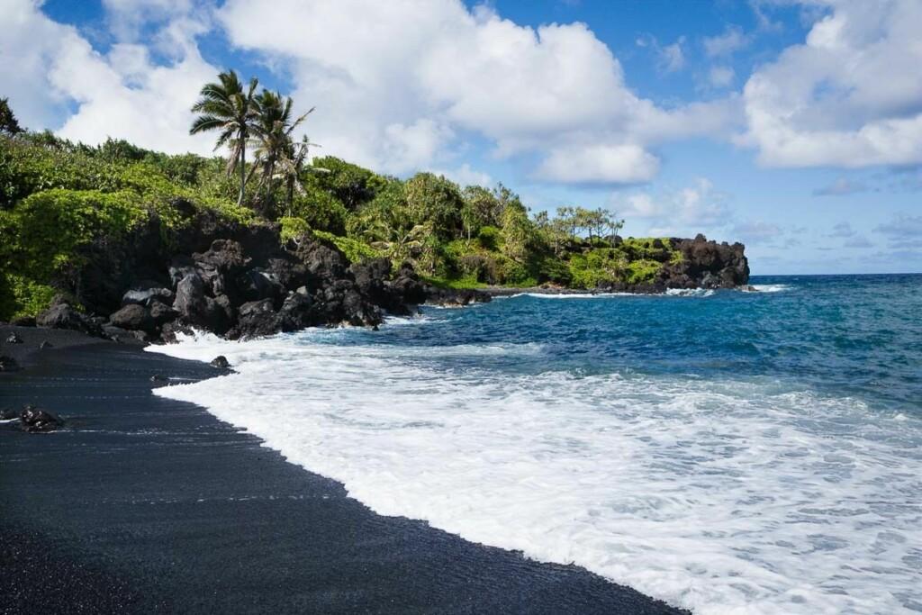 black sand beach in Hawaii, representing black in nature