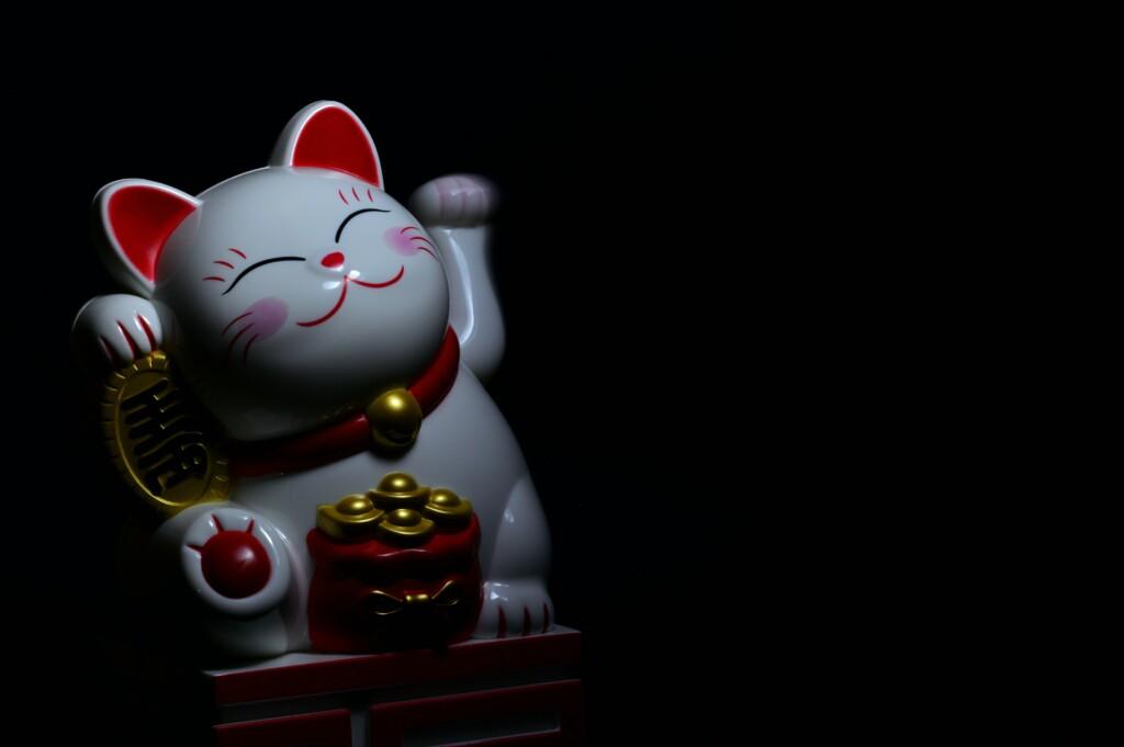 white cat statue on a dark background