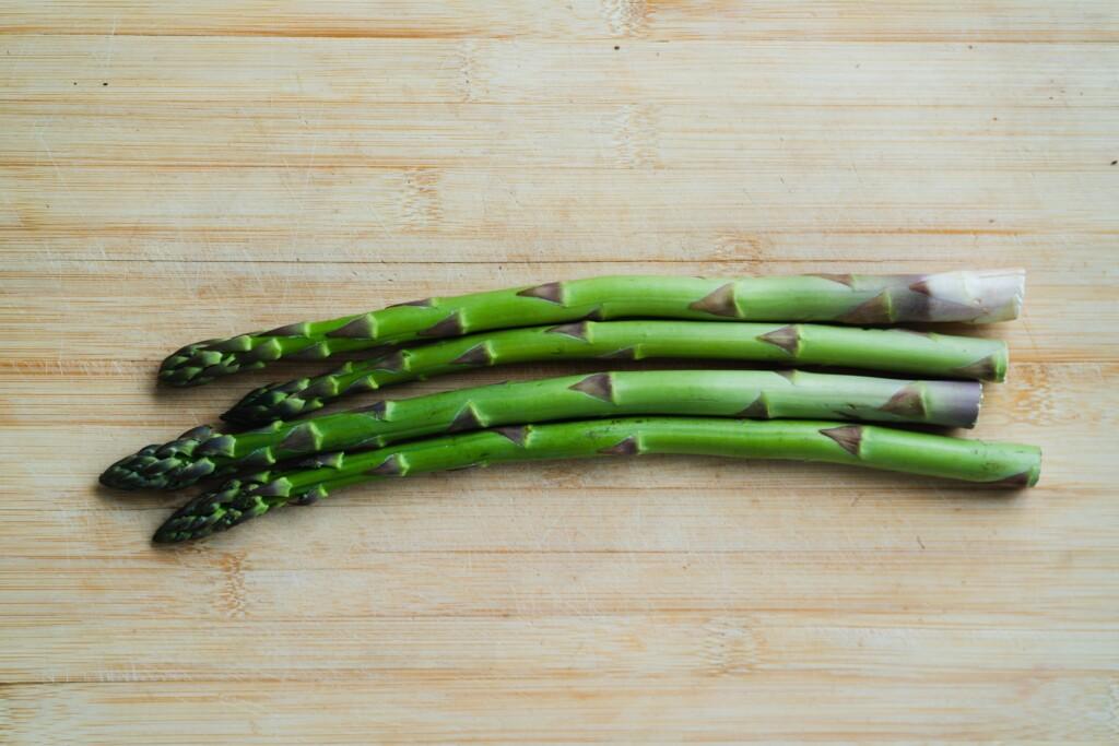 four asparagus on the table