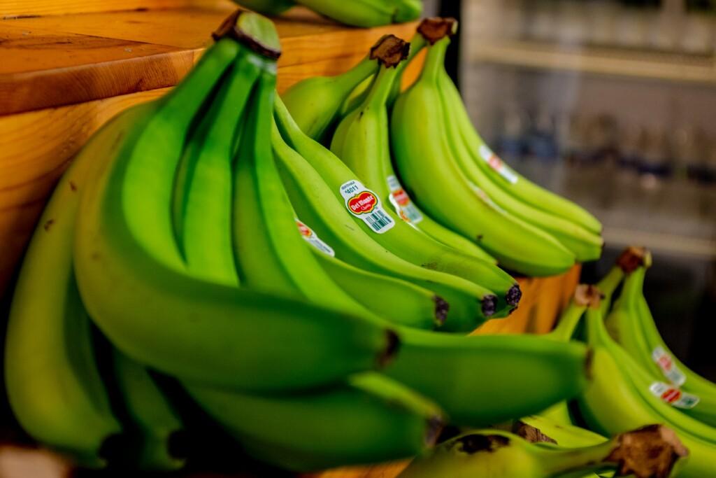 green bananas on the store shelf