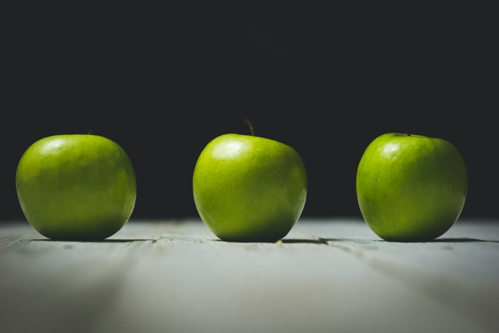 three green apples next to each other