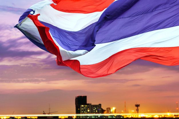 waving flag of Thailand consists of bands of red on the outside, stripes of white, and a double width blue stripe in the middle