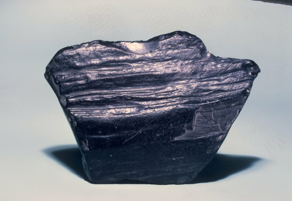 a piece of raw black jet gemstone, featuring black in nature