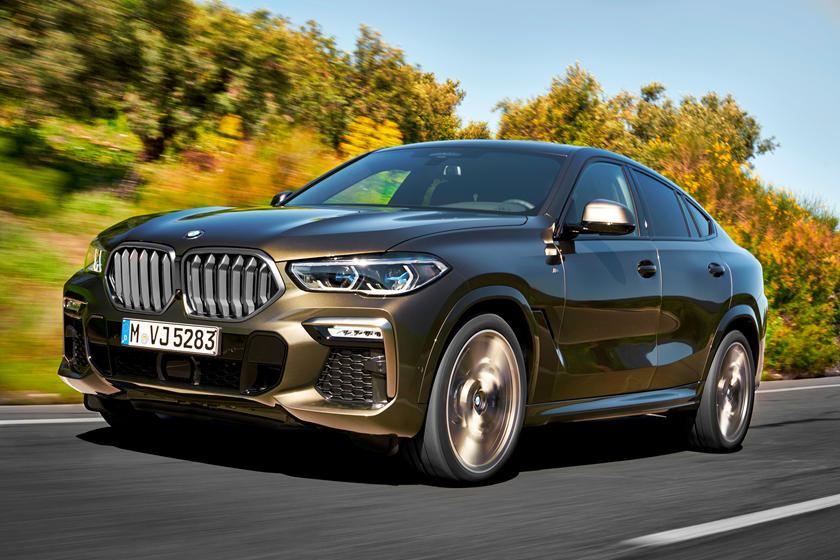 A brown BMW X6 on the road, brown car