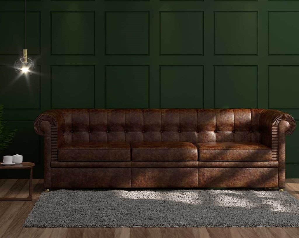 A brown sofa in in front of a green wall, brown in interior decoration