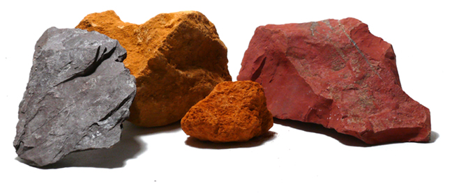 four pieces of stones that provide brown color, raw sienna, umber