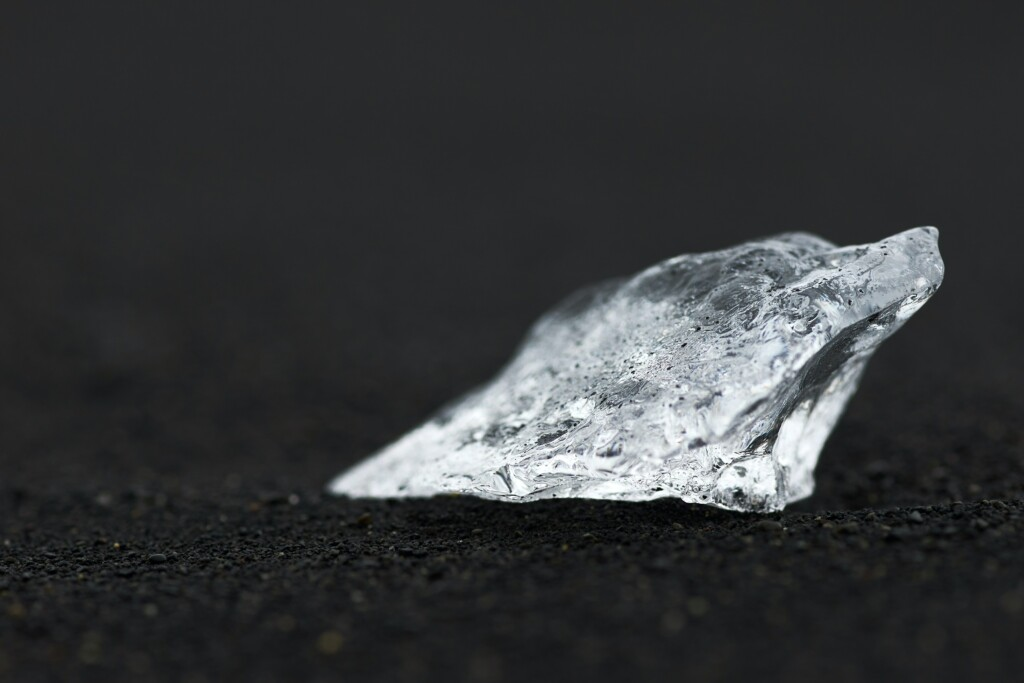 a piece of silver metal on the floor