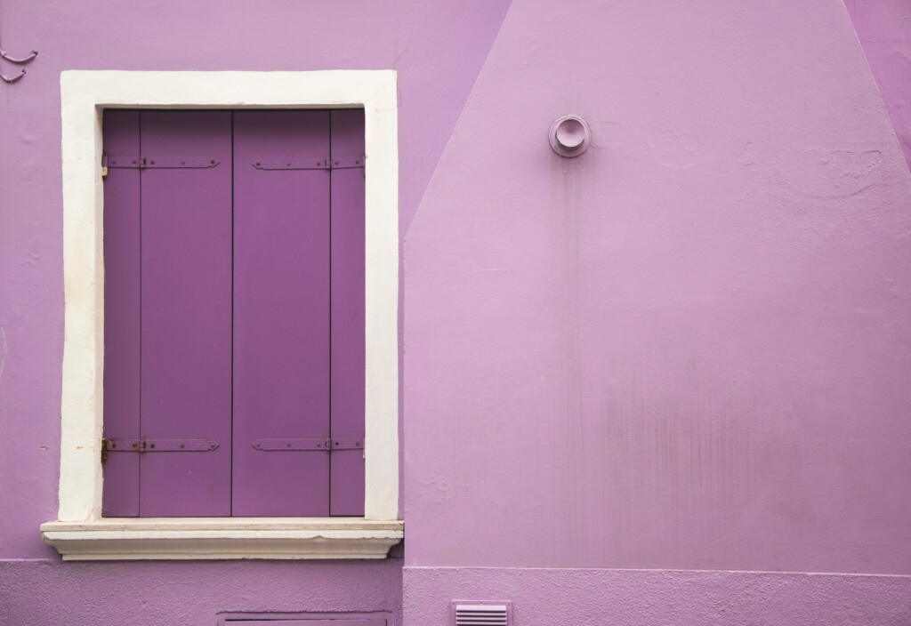 the wall and door of a purple house